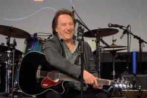 DENNY LAINE ON GIVING FLIGHT TO WINGS, TOURING WITH GINGER BAKER AND THE MOODY BLUES' HALL OF FAME INDUCTION