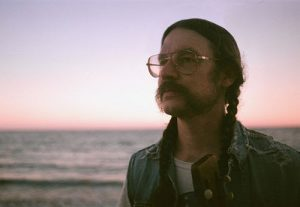 DAN HORNE OF CIRCLES AROUND THE SUN TAKES A SOLO SPIN ON HIS 'MOTORCYCLE'